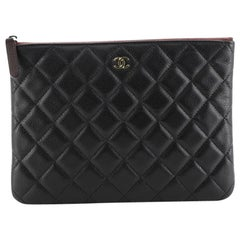 Chanel O Case Clutch Quilted Caviar Small