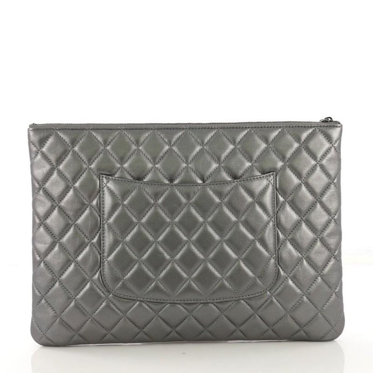 9e08eedb4a50df Chanel O Case Clutch Quilted Lambskin Large In Excellent Condition For Sale  In New York,