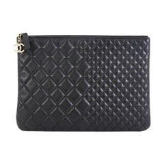 Chanel O Case Clutch Quilted Lambskin Medium