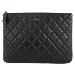 Chanel O Case Clutch Quilted Lambskin Small