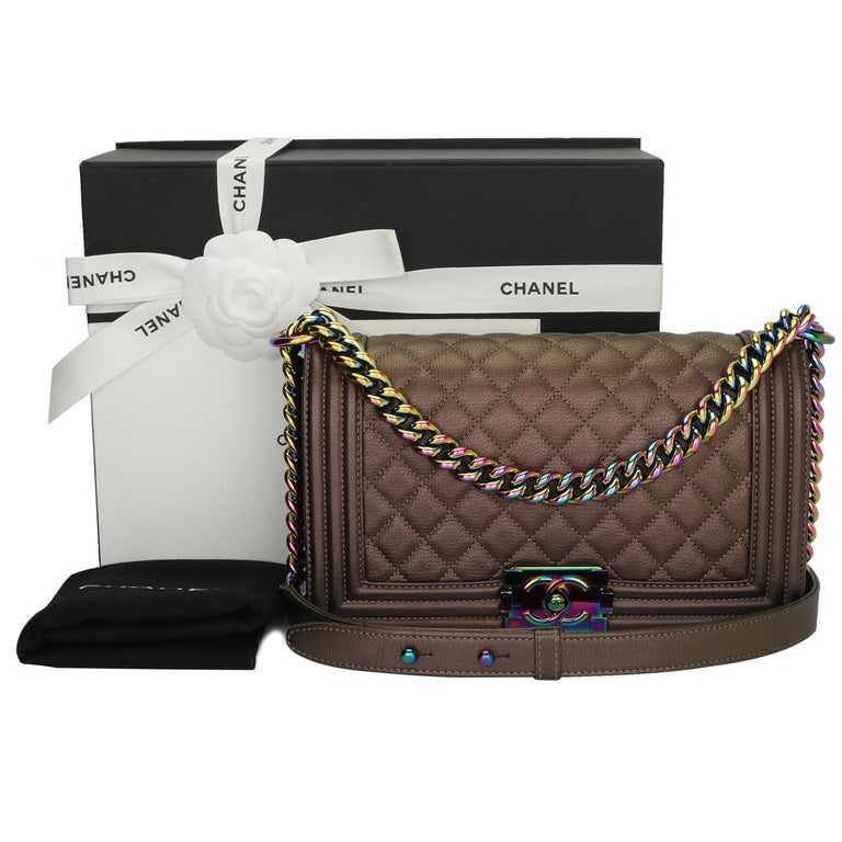 Authentic CHANEL Old Medium Boy Bag Bronze Iridescent Goatskin with Rainbow Hardware 2016.  This stunning bag is still in excellent condition, the bag still holds its shape very well and the hardware is still very clean and shiny.  Exterior