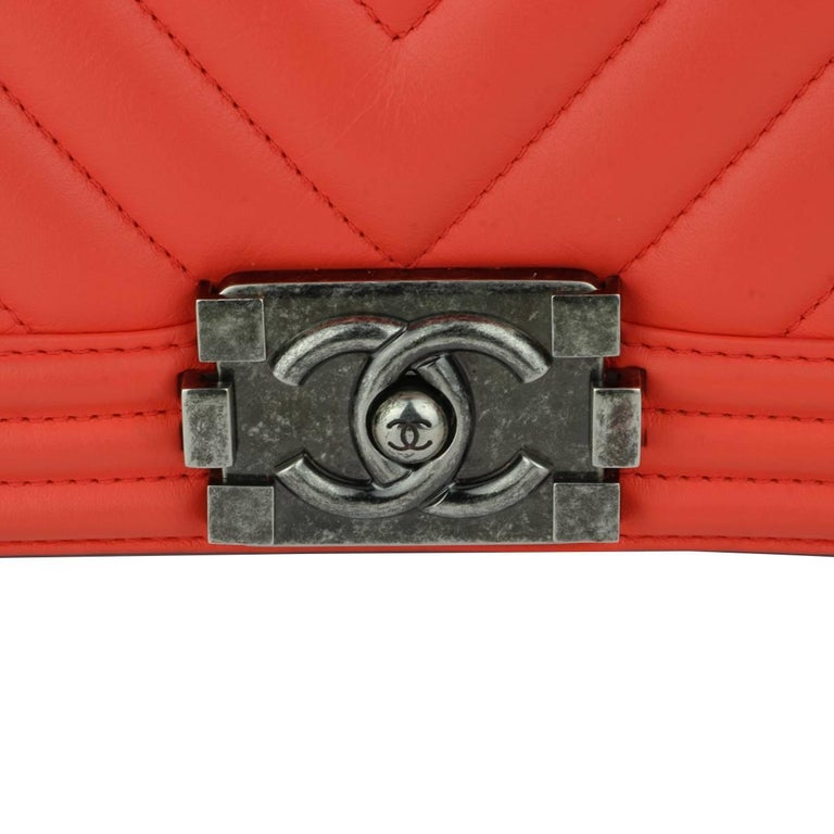 Authentic Chanel Old Medium Peachy Red Chevron LeBoy Calfskin with Ruthenium Hardware 2016.  This stunning bag is still in a mint condition, the bag still holds its original shape, and the hardware is still very clean and shiny. Calfskin leather