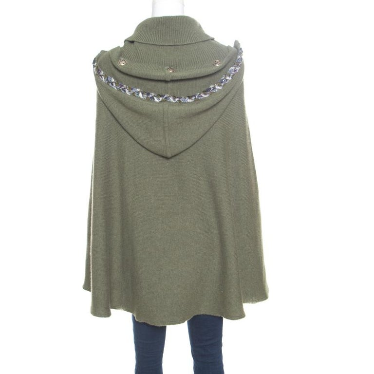 Our hearts have gone to this fashionable poncho from Chanel! It comes made from cashmere and designed with tweed trims, a turtle neck, slots for the hands, and a hood. For a high-fashion look, team it with leather leggings and pointed-toe ankle