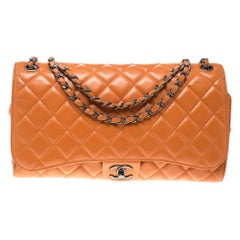 Chanel Orange Leather Drawstring Flap Shopping Bag