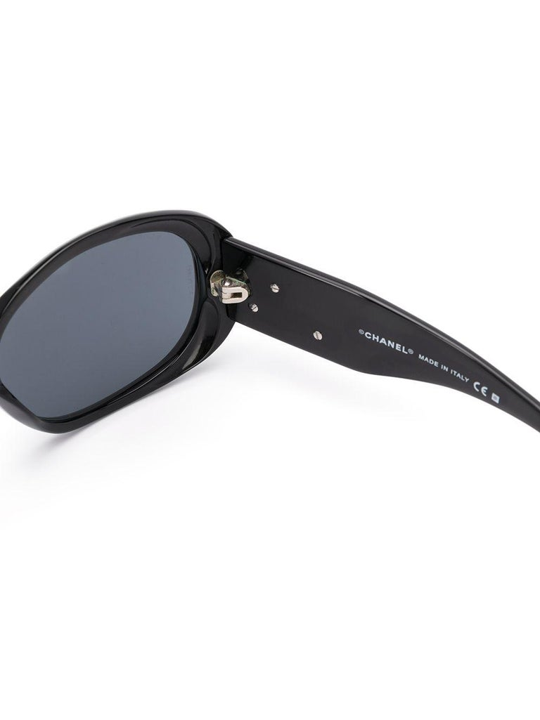 Crafted in France from pure black acetate, these sunglasses elevate a classic silhouette with round, oversized-frames, tinted lenses and straight arms with curved tips.  This item includes its original leather protective Chanel case and lens