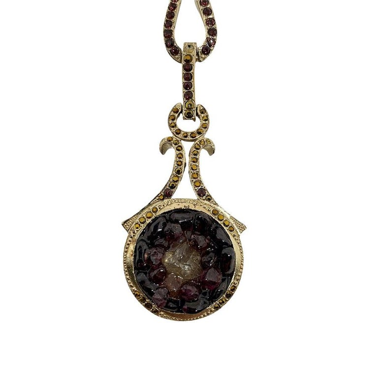 It comes from Maison CHANEL. With rhinestones, amethyst and rock crystal, this jewel can be pricked at the top of the skull with hairpins to let it hang on the forehead.  Never worn. Length : 16 centimeters.  It is from the collection Paris-Bombay