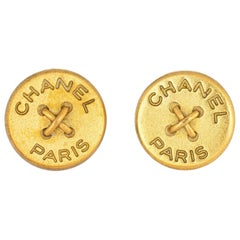 Chanel Paris Button Earrings Circa 1994 Yellow Gold Tone Round Clip On