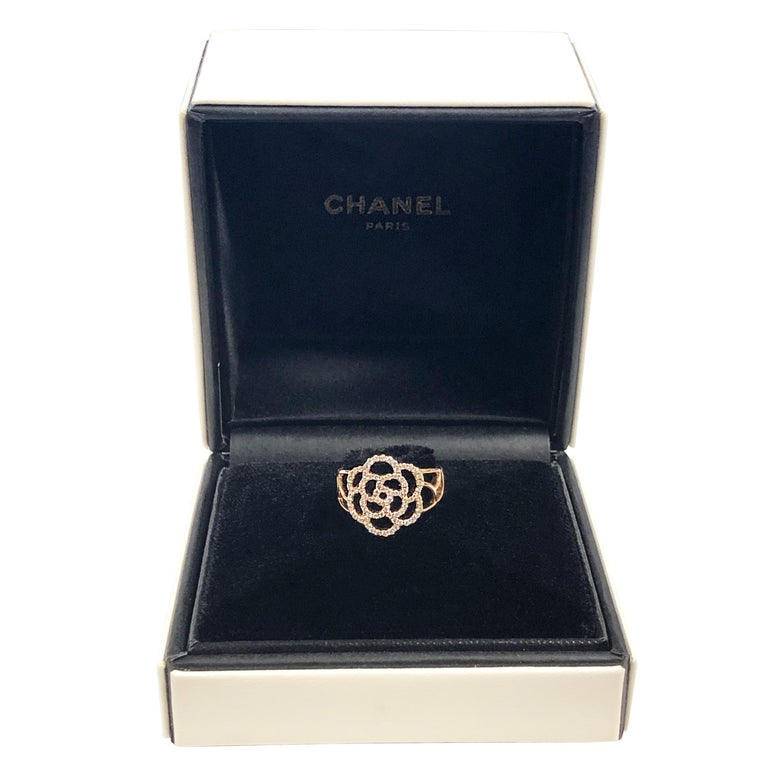 Circa 2017 Chanel Paris Camelia collection 18K Rose Gold Ring, set with Round Brilliant cut Diamonds totaling 1 Carat. The top of the Ring measures 5/8 inch across, finger size 6 ( 52 European ) Near unworn excellent condition in original
