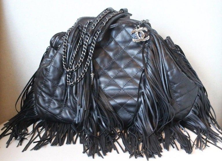 509fdd12ab35 This authentic Chanel Paris-Dallas Drawstring Fringe Shoulder Bag Quilted  Leather presented in the brand s