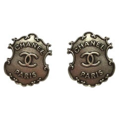 CHANEL Paris-Dallas Stud Earrings in Aged Silver Metal