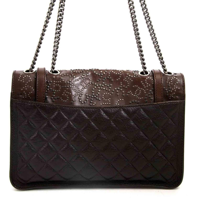 Very good condition  Chanel Paris Dallas Studded Lambskin Western Bag   The Paris Dallas Chanel collection contains some of the most unique bags, like this beautiful design.  It's crafted from lambskin leather in different brown tones and finished