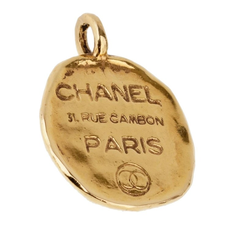 A vintage Chanel pendant engraved with the house of Chanel's address 31 Rue Cambon Paris in 18k yellow gold.