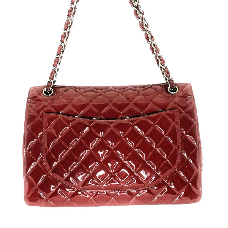 Prune diamond quilted Patent Calfskin leather Chanel Classic Maxi Double Flap bag with silver-tone metal hardware, convertible chain-link and leather shoulder strap, single patch pocket at back, single zip pocket at flap underside, three interior