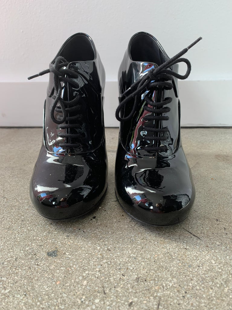 Chanel ,Black Patent , Stiletto Ankle Boots . GREAT condition . Barely any signs of wear. Classic style - timeless.  Size 38.5