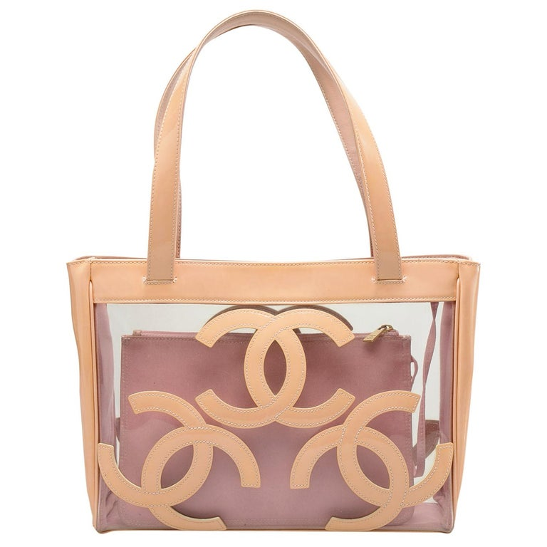 A lovely and unique creation from the house of Chanel, this Triple CC tote in medium size makes for an ideal bag for shopping outings, Sunday brunches and beach days. Rendered in clear PVC with light patent leather trims, the tote is styled three CC
