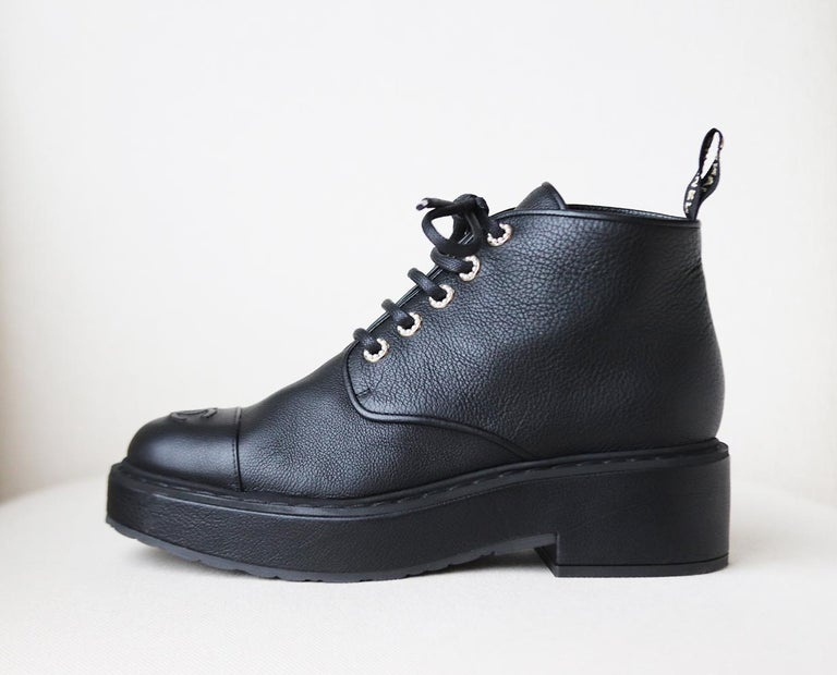 These beautiful Chanel boots are made from soft grained calfskin leather set on a leather lined platform sole, they are embellished with pearl detail around the laces and embroidered detail on the back of the boots. Heel measures approximately 50mm/