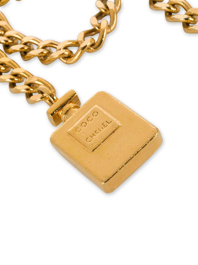 Indulge in the world of vintage luxury with this rare 1990s belt by Chanel. Crafted in France from gold-plated metal, this flattering accessory features a three drop strand tiered design, a simple hook fastening and an embossed 'Coco Chanel' perfume