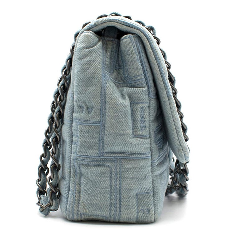 Chanel Perfume Embroidered Denim Flap Bag  CC turn-lock closure; silver hardware; flat pocket on the back; denim entwined chain strap; interior open pocket; Made in France   Please note, these items are pre-owned and may show signs of being stored