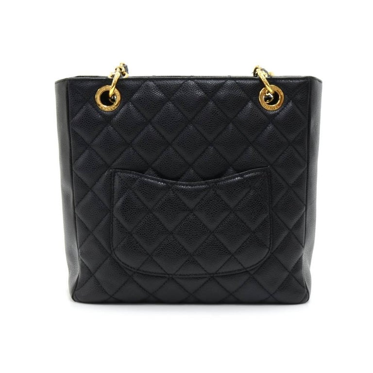 Chanel PST tote in black quilted caviar leather. Top has magnetic closure and 1 small open pocket on back. Inside has textile lining and 2 pockets: 1 open and 1 with zipper. Can be carried on the shoulder. SKU: CG539  Made in: Italy Serial Number: