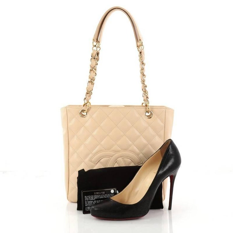 a9c4141369a3 This authentic Chanel Petite Shopping Tote Quilted Caviar is the perfect bag  that complements any outfit