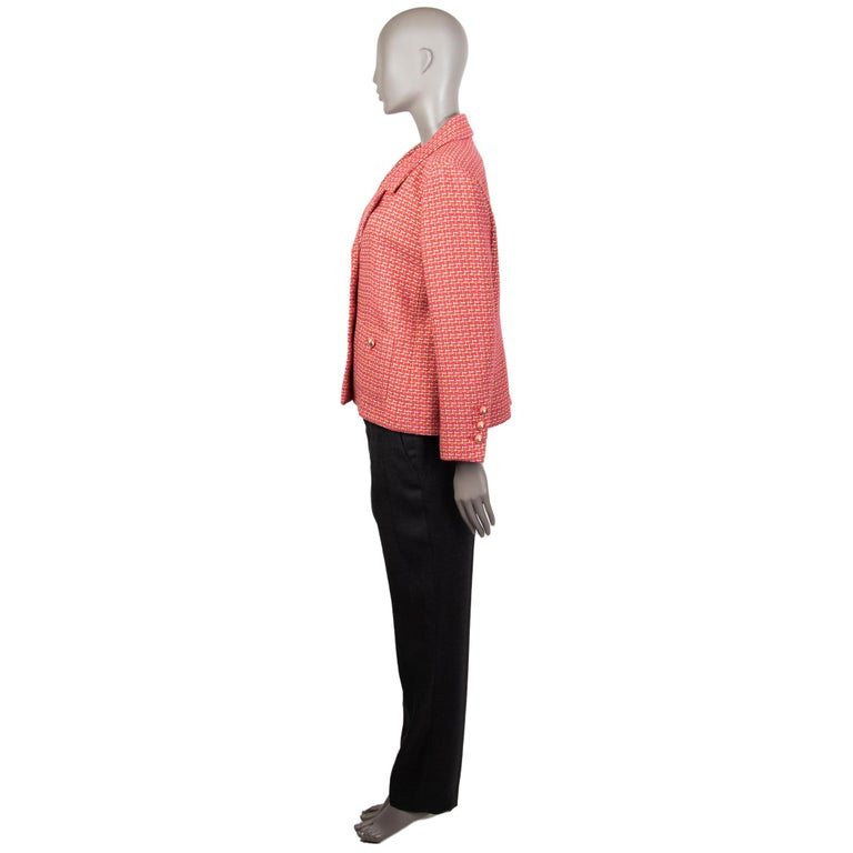 Chanel tweed blazer in watermelon, lime, silver, and off-white cotton (73%), polyester (16%), and nylon (12%). With notch collar, buttoned patch pockets on the front, buttoned sleeves, and signature chain around the inside of the hemline. Closes