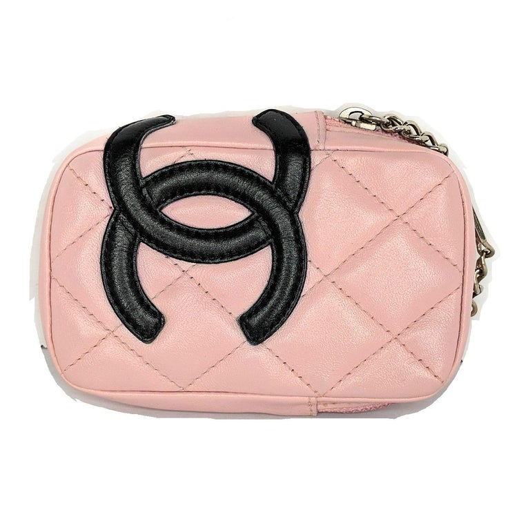 Pink quilted leather Chanel Mini Ligne Cambon Cosmetic Pouch with silver-tone hardware, interlocking CC logo at front, single exterior belt loop, pink logo jacquard lining and zip-around closure at top. Includes a complimentary dust