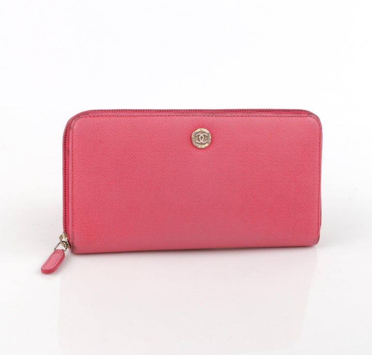 CHANEL Pink Coated Canvas CC Logo Zip Around Clutch Wallet  Brand / Manufacturer: Chanel Style: Ziparound Wallet Color(s): Pink (exterior); shades of tan (interior) Unmarked Materials: Coated canvas with texture leather similar to saffiano leather