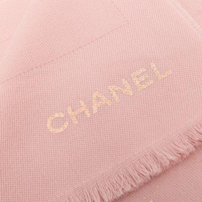Wrap up in style and luxury comfort with this stunning yet understated rosey-pink coloured scarf from Chanel. Crafted from 100% wool. Measures 200cm x 80cm  Colour: Pink  Composition: 100% Wool  Condition: Excellent condition  This Chanel® item has