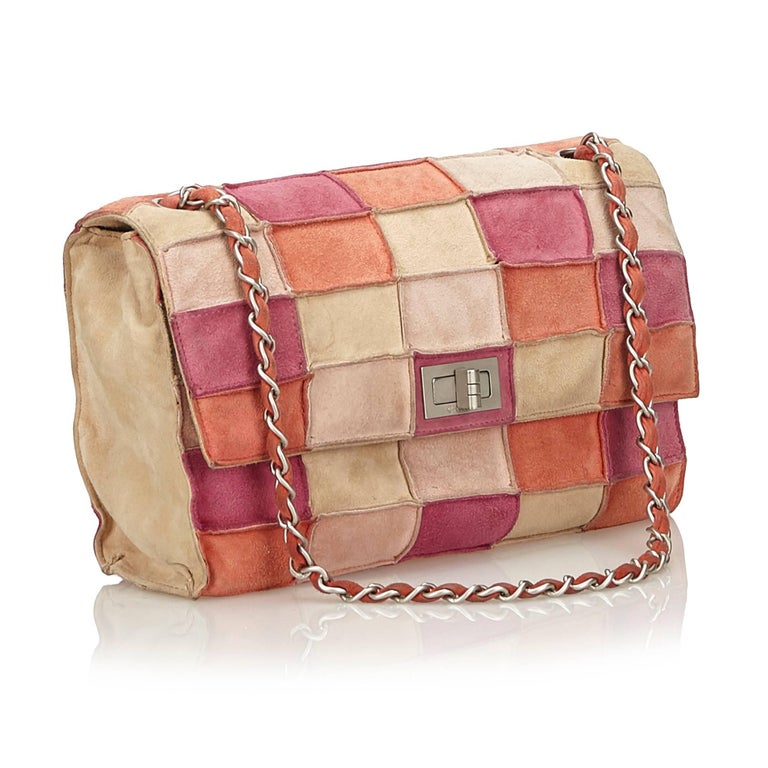 28ce2158f024 Chanel Pink x Multi Reissue Patchwork Flap Bag For Sale. This shoulder bag  features a suede patchwork body, a silver-tone shoulder chain,