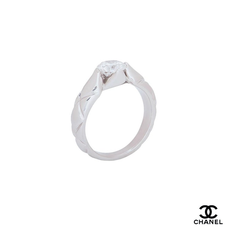 A platinum diamond engagement ring by Chanel from the Coco Crush collection. The ring comprises of a round brilliant cut diamond in a four claw setting with a weight of 1.03ct, F colour and VS1 clarity. The ring is a size UK R/US 8.5/EU 58 but can