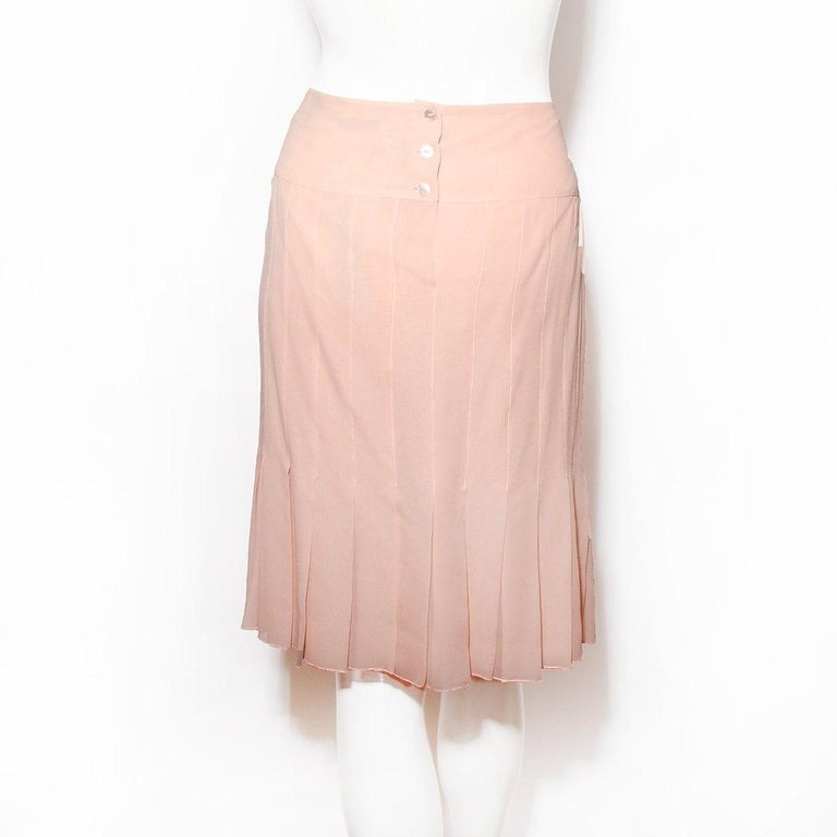 Pleated skirt by Chanel  Fall/winter 2003 RTW collection Pink color  Button back closure  High waist 100% silk Made in France Condition: Excellent, like new. Tags still attached. (see photos) Size/Measurements: (approximate, taken flat)  Size 44 32