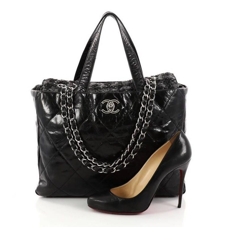 89afbc4a52f6 This authentic Chanel Portobello Tote Quilted Glazed Calfskin and Tweed  Medium is a luxurious bag that