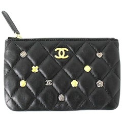 CHANEL O Pouch – Black Lambskin with Gold charms - New Condition