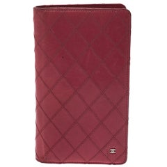 Chanel Punch Pink Quilted Leather Vertical Flap Wallet