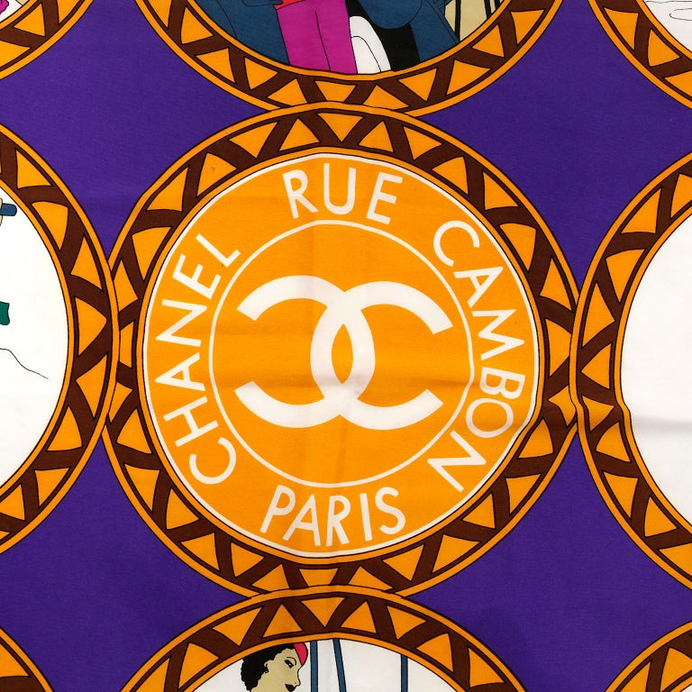 Chanel Purple Silk Rue Cambon Scarf - excellent condition.   Regal purple background with gold and white accents.  Vintage athletic pastimes are depicted in each circle.  Each model is fashionably attired in, of course, Chanel.   Measurements:  36""