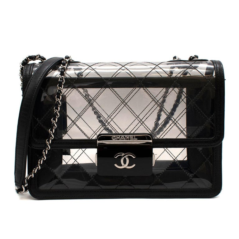 Chanel PVC Lambskin Quilted Lock Flap Bag  - Slim Silver-tone hardware chain - Diamond stitched outer  - Black Resin Square closure with silver tone CC - Two internal compartments  - Original dust-bag and box included   Made in Italy   length: