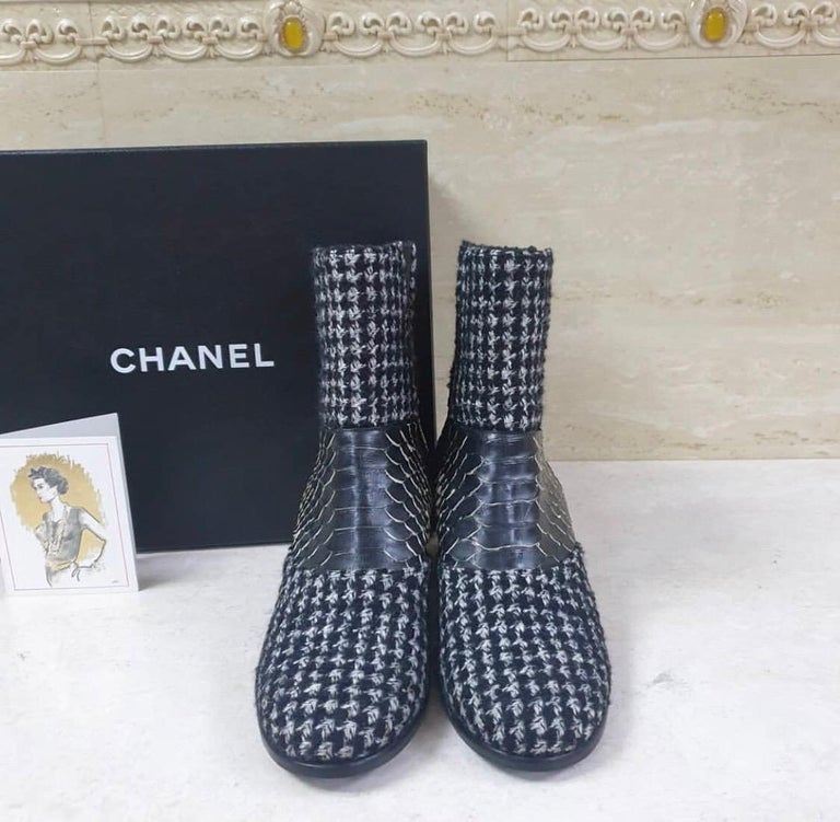 Black and multicolor tweed Chanel round-toe ankle boots with python accents at uppers, elasticized gores at sides and covered heels featuring interlocking CC. 'C' indicates this shoe runs wide. Fit: This style typically runs a full size small. From