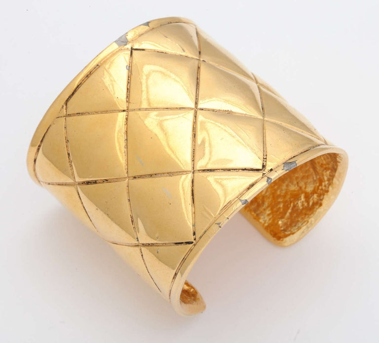 Chanel gold tone bangle bracelet with quilted details, it has a small CC logo on the side. Signed Chanel made in France.