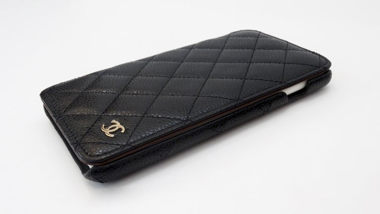 Accessorize your phone with this adorable Chanel iphone plus case! Circa recent 2000s, this iphone 7 or 8 plus case is crafted from durable black caviar quilted leather and features the signature quilted stitching. Includes a silver toned CC in the
