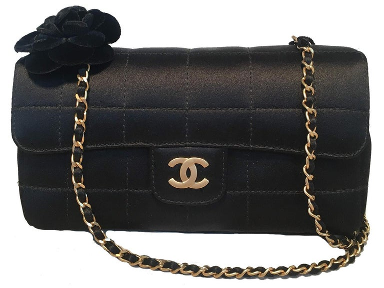 Chanel Quilted Black Silk Mini Camellia Classic Flap Shoulder Bag in excellent condition. Square quilted black silk exterior trimmed with matte gold hardware and an adorable velvet camellia flower along the top right side at one end of the woven