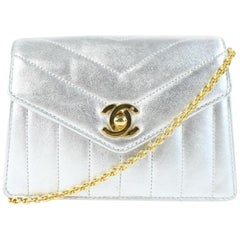 Chanel Quilted Chevron Mini Flap 03cz0717 Silver Metallic Leather Cross Body Bag