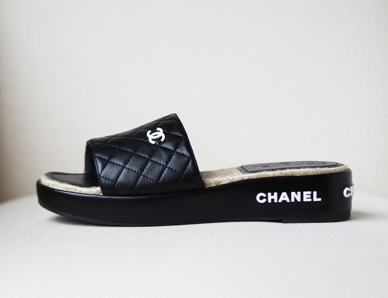 Chanel's slides are inspired by the 'flatform' sandals and espadrilles combined, set on high soles, they're designed with quilted lambskin leather accents and raised white logo on the back and side. Rubber sole measures approximately 45mm/ 1.8