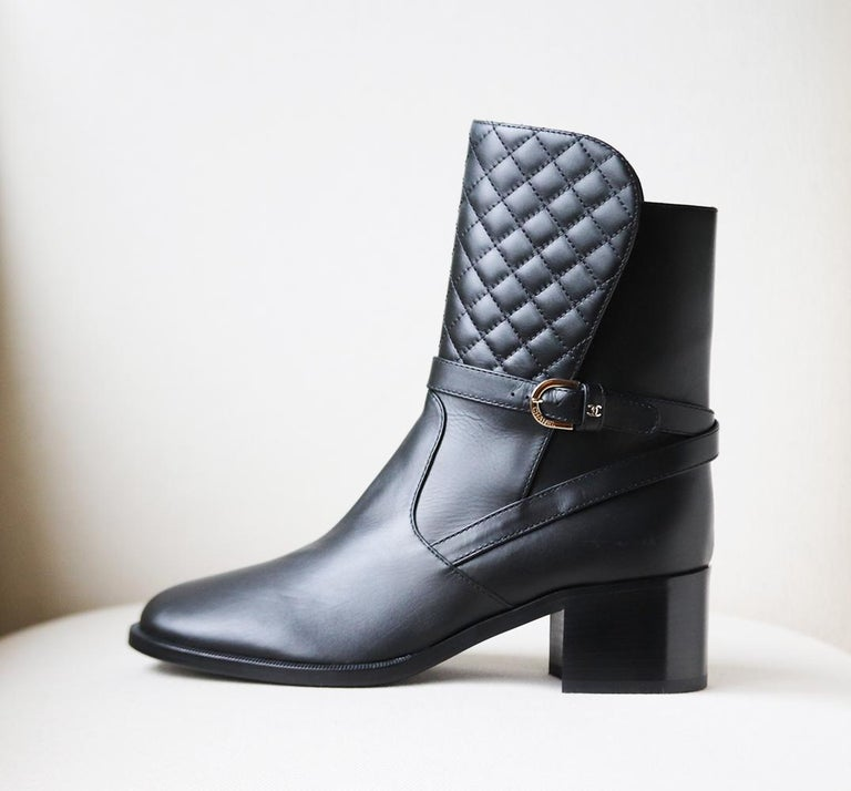 These beautiful Chanel boots are made from soft quilted lambskin leather, they are adorned with a logo embellished silver-tone buckle detail at the side and finished with a slight heel. Heel measures approximately 50mm/ 2 inches. Black