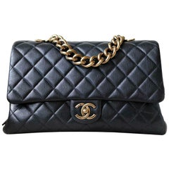 Chanel Quilted Leather Large Trapezio Flap Bag