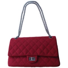 Chanel quilted red jersey 2.55 bag with silver plated chain handle
