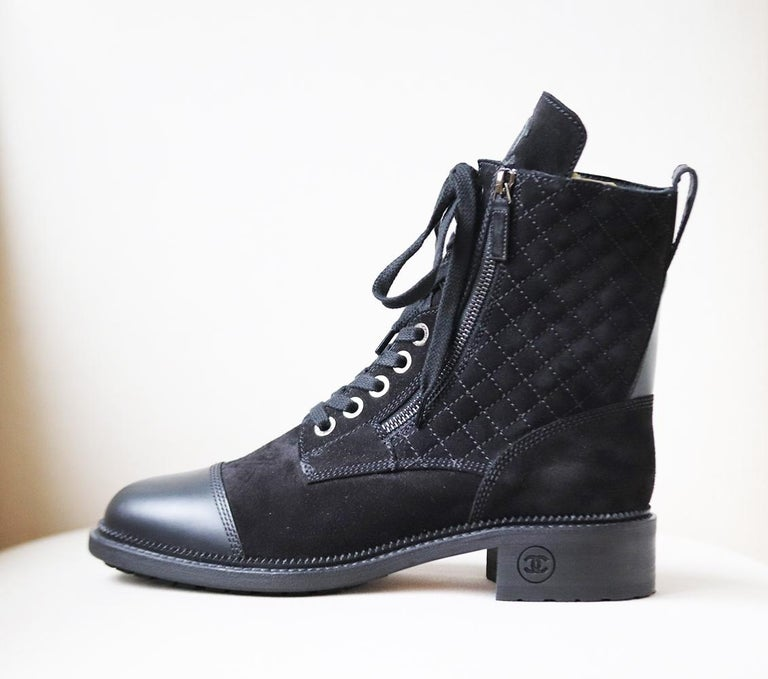 These Chanel boots have a hiking-inspired twist and are is made from panels of supple quilted-suede and leather and set on a gripped rubber sole, the plush CC logo on the extended front lip will keep your feet warm even on the chilliest of