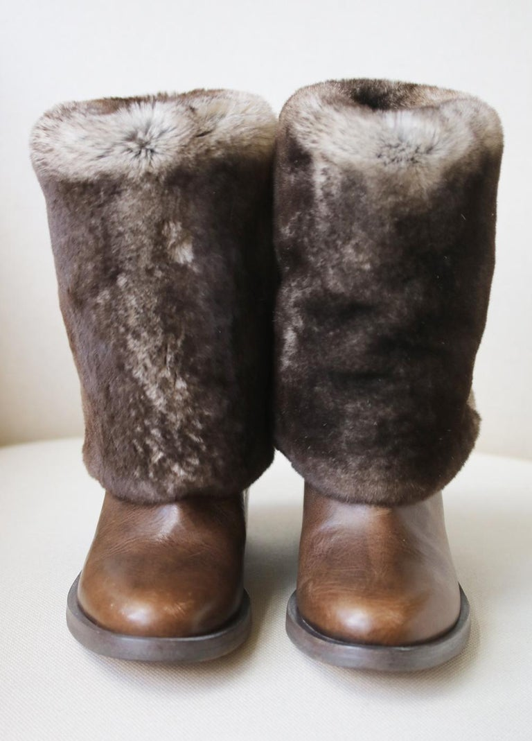Chanel rabbit-fur and leather ankle boots perfect for the colder days.  Sits above the ankle.  Fold-over rabbit-fur flap.  Slip-on.  Stacked heel.  Calfskin leather.  Fur type: rabbit.  Fur Origin: Spain.  Colour: brown.  Does not come with a box.