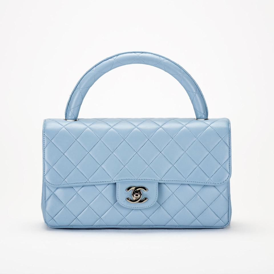 A 1990s light-blue quilted-leather Chanel top-handle flap bag, offered by House of Carver