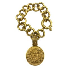 Chanel Rare Vintage Gold Tone Filigree Bracelet with a Hanging CC Medallion