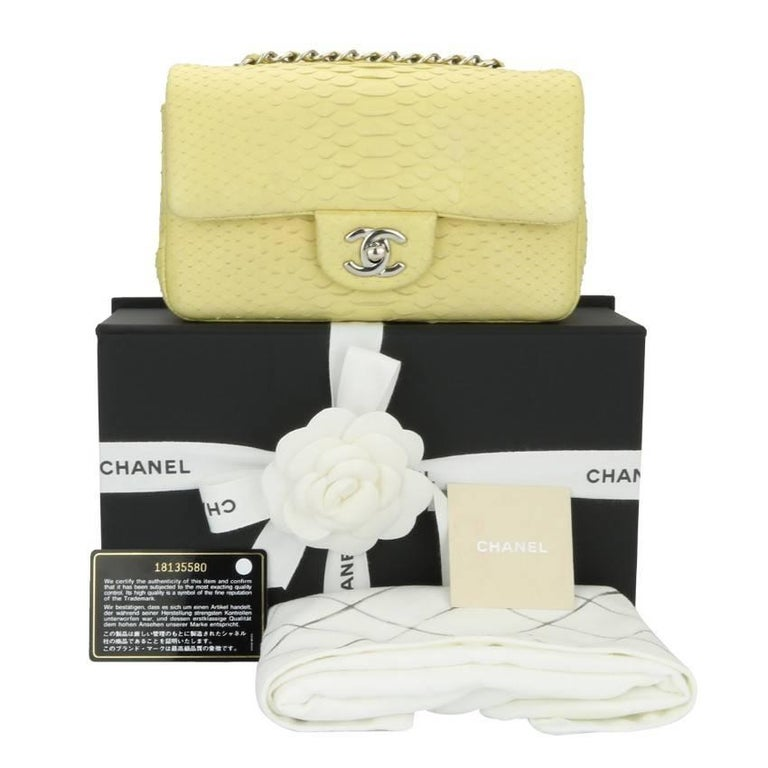5bf561a3a266 CHANEL Rectangular Mini, Yellow Python with Silver Hardware 2014 Limited  Edition. This bag has